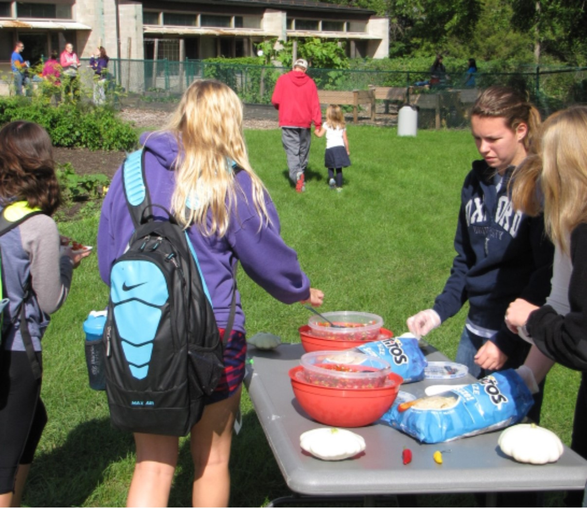 Students eating Salsa at the Salsa Festival