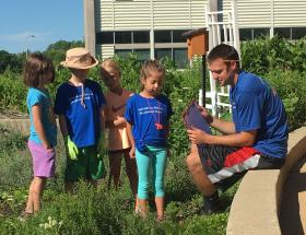 Joey with kids in rain garden